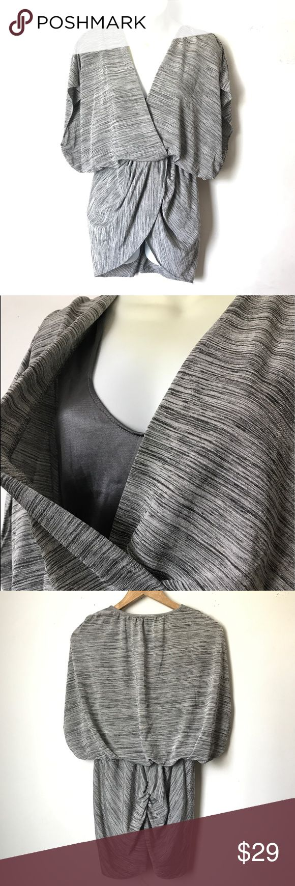 """Bebe Batwing Tunic Top 2B Bebe Women's Batwing Sleeve Tunic Top Blouse Shirt  Size- Small Color- Metallic Gray  Condition- New Without Tag  APPROXIMATE MEASUREMENT ( lying flat) Armpit to Armpit & Bust-Undefined Waist- Stretchable 13"""" across From Shoulder to Hem-30.5""""  A-546 2B Bebe Tops Tunics"""