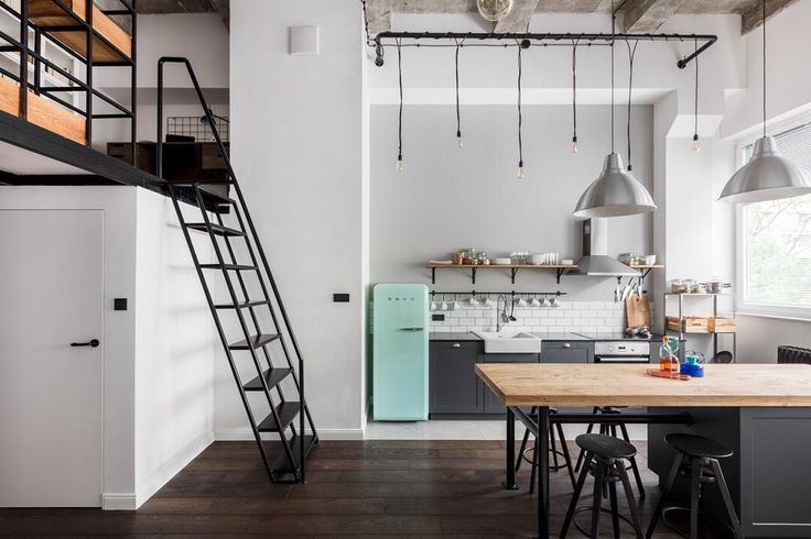 Welcome to this absolutely gorgeous #apartment in Poland's capital #Warsaw! The photographers at Ayuko Studio did a great job capturing the #flat's #industrial feel and #contemporary #style! Get your daily dose of #inspiration on #homify!  #design #moderndesign #interior #interiordesign #moderninterior #openplan #openplanliving #kitchen #lights #lighting #ladder #loftedbed #modernliving #cityliving
