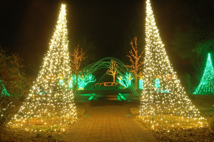 A view through the Tunnel Fountain to the Scroll Garden during Holidays at the Garden 2013, at Daniel Stowe Botanical Garden