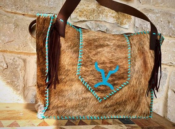 another perfect color combination that you just cant go wrong with on our livestock brand bags! love this very versatile cowhide. these bags are completely made out of leather from the cowhide to the deerskin lacing no expense was spared as we wanted quality first bag measurements 17