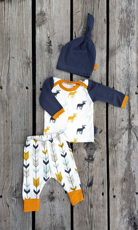 Perfect fall or winter outfit for your baby boy! The most adorable 3 piece set made of organic and jersey knit; the shirt made of gray, golden