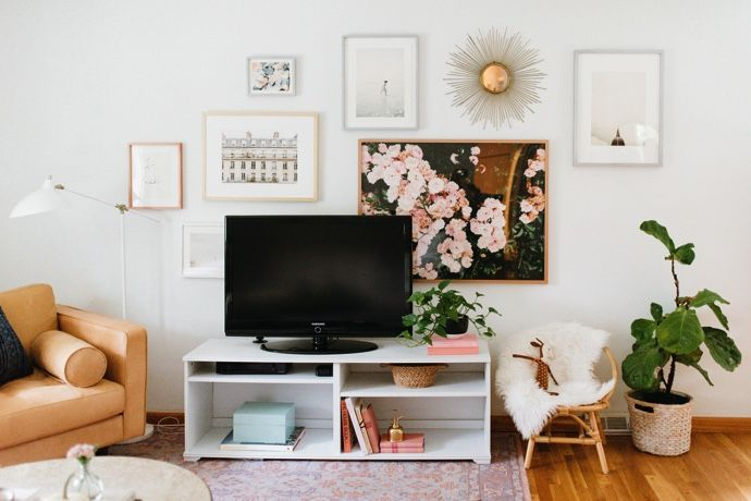 caitlin kruses living room makeover | the glitter guide | love the gallery wall behind the tv