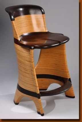 Kitchen chair made out of two different types of wood Music in
