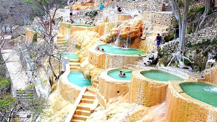 Las Grutas de Tolantongo is a natural spa resort in the Mexican state of Hidalgo. Thanks to the surrounding volcanic mountains, thermal springs spill out into incredible hot springs that hang off the side of a cliff.