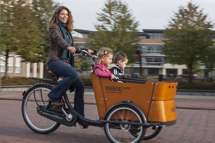 Babboe Curve with two kids in the container. A 3-wheel cargo bike with a new design.