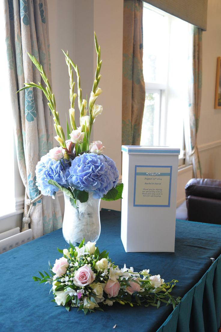 Contemporary Urn arrangement with Gladioli, hydrangea and Avalanche roses, card box and Bride's traditional waterfall bouquet.