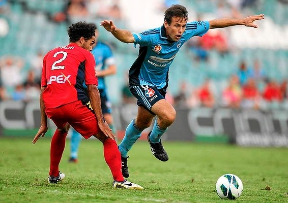 Paul Reid of Sydney FC skips out of a tackle during the A-League match between Sydney FC and Adelaide United. 16 Feb 2013.