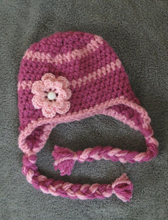 Gorgeous pink flower toque with ties - so pretty!  Ask about custom orders for a different colour - sisters could have matching pink and purple hats! :)