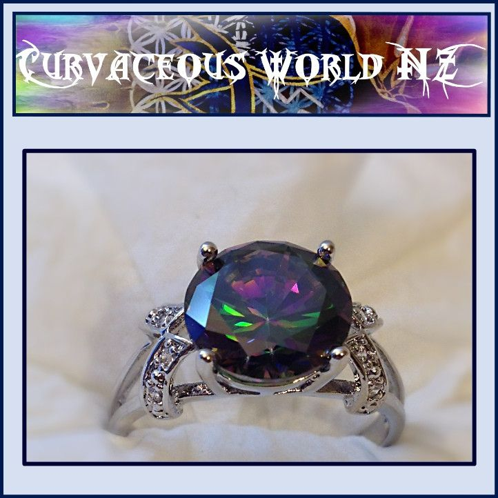 Solitaire Rainbow Topaz Silver Ring NZ$30.00 #CurvaceousWorldNZLtd #affordable #fashionearrings #freeshipping #summertops #chiffontops #plussized #lovemybroaches #ilovesummer #curvaceouswomenrock