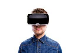 Man wearing virtual reality goggles. Studio shot, white backgrou stock photo