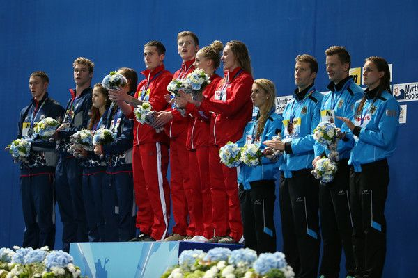 Gold medallists Chris Walker-Hebborn, Adam Peaty, Siobhan-Marie O'Connor and Fran Halsall of Great Britain pose with silver medallists Ryan Murphy, Kevin Cordes, Katie McLaughlin and Margo Geer of the United States and bronze medallists Jan-Philip Glania, Hendrik Feldwehr, Alexandra Nathalie Wenk and Annika Bruhn of Germany during the medal ceremony for the Mixed 4x100m Medley Relay Final on day twelve of the 16th FINA World Championships at the Kazan Arena on August 5, 2015 in Kazan…