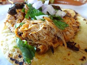 Hand-shredded chicken tacos at Big Easy Roasted Corn & Churros are served with cilantro, onions and a house-made spicy, smoky sauce. - MEGAN BRADEN-PERRY