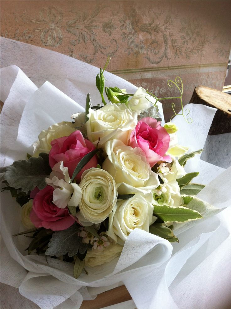'Irresistible' fragrant roses, double ranunculus and sweet peas. Soft and romantic with garden vibes.
