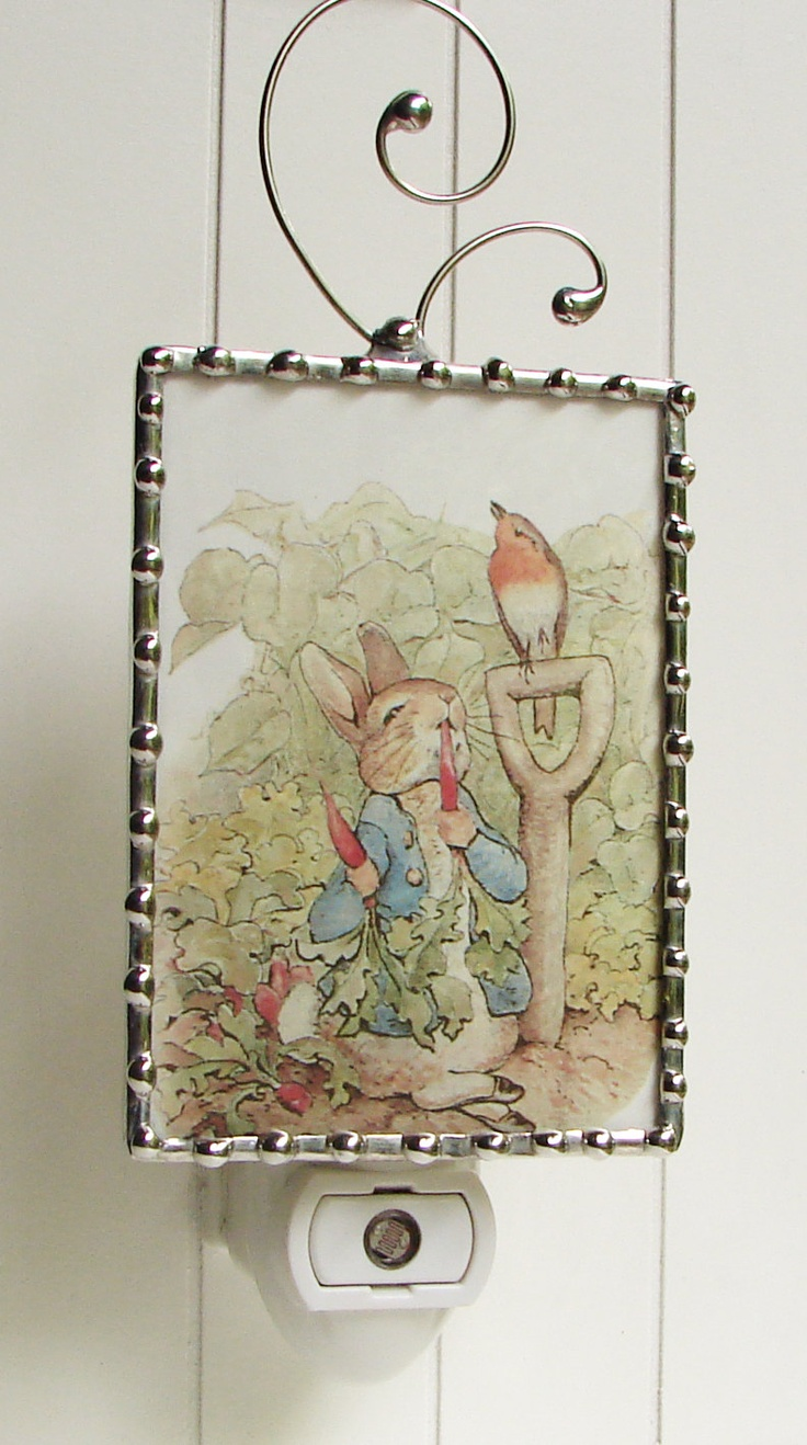 If I could get her to leave the swirly thing off the top, this would be perfect for the nursery!  Child's Night Light Peter Rabbit - Nightlight  Vintage Storybook Image - Kids Night Light - Beatrix Potter. $25.00, via Etsy.