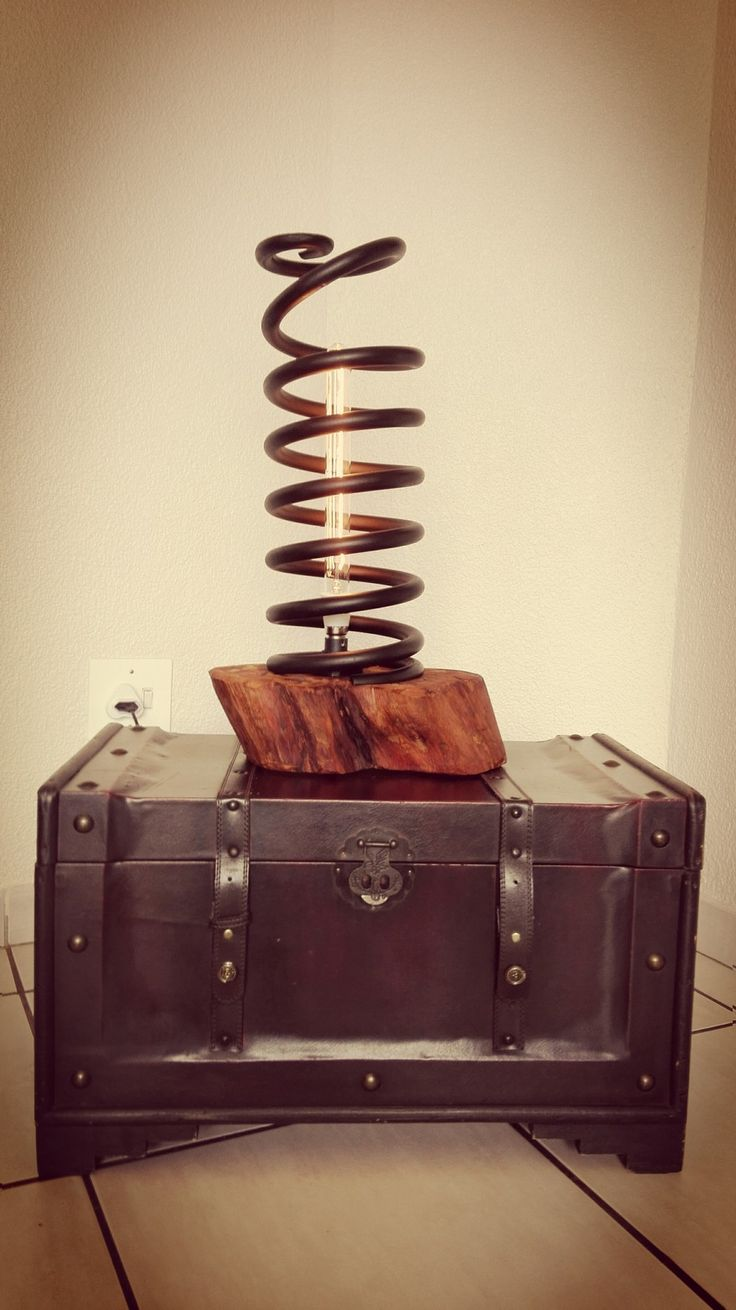 One of a kind upcycled Truck Spring Lamp with Knysna Yellow Wood base.  Inustrial Chic at its best!  Sale Price R1950.00 / Floor Price R2250.00.  Call and Collect yours today +27615246518