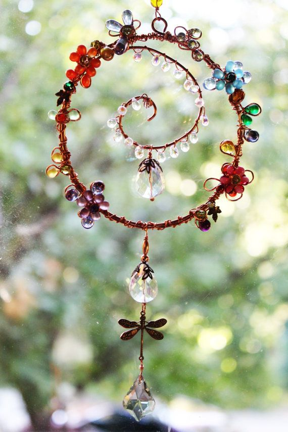 Full of Spring colors is this elegant glass beaded sun catcher. This beautiful piece can be hung outdoors, in a window or hang it on your cars rear view mirror. Made with czech glass briolettes, czech beads, sea glass beads and a copper dragonfly. All perfectly wrapped with copper wire in several gauges. Measures 14 to the tip of the bottom briolette . FREE domestic shipping  Thank you for looking.