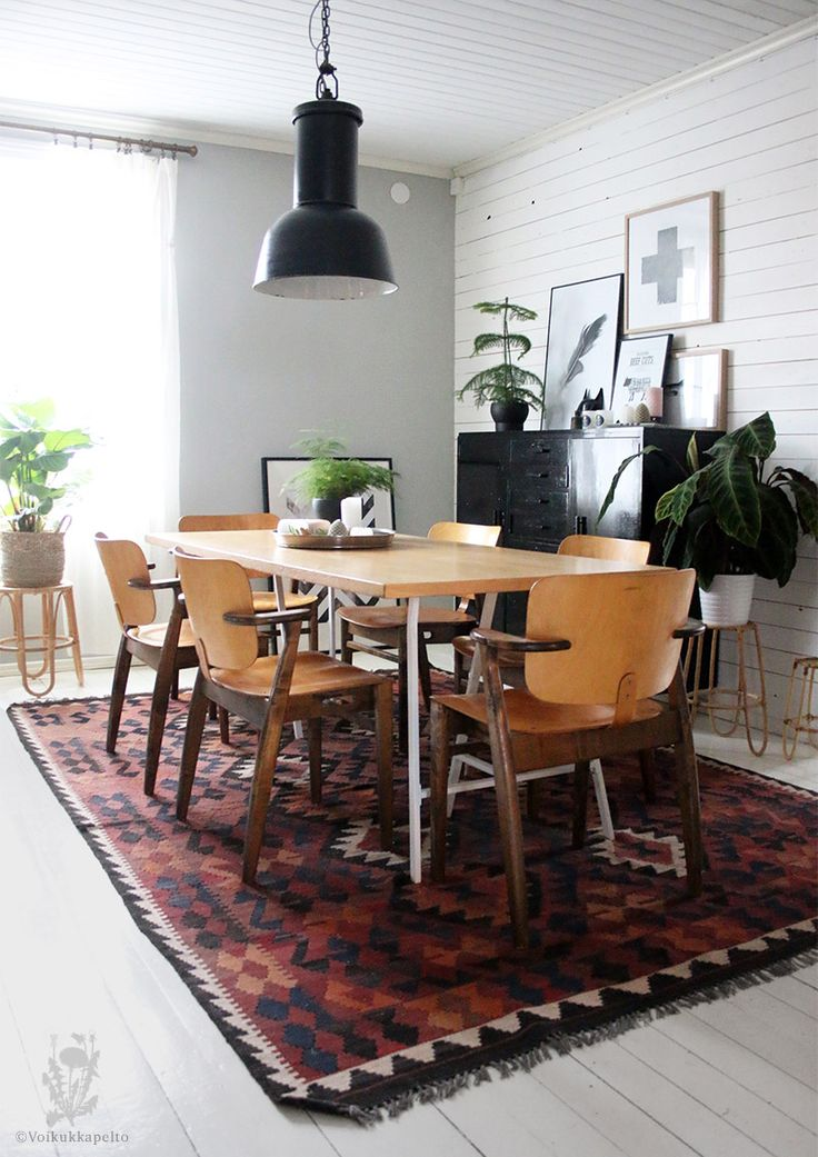 Dining room. Domus chairs by Tapiovaara. Vintage kilim rug. Industrial lamp.
