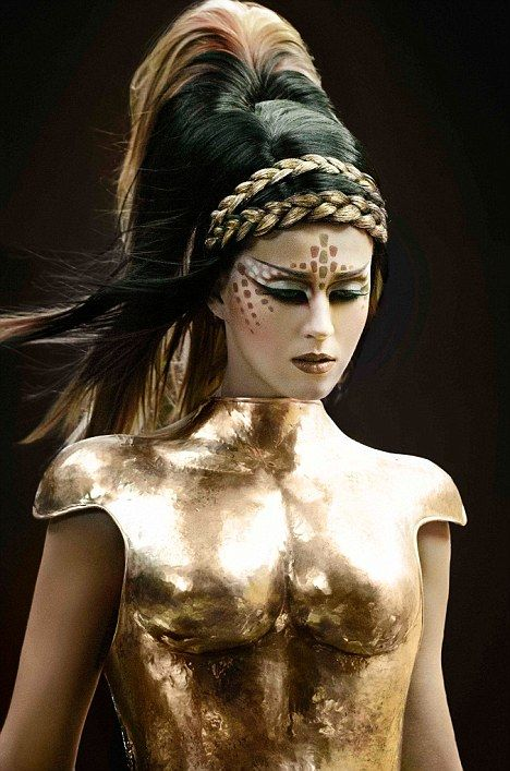 Going for gold: Katy Perry looks like a gladiator in her gold breast-plate in a promotional shot for her new single E.T.
