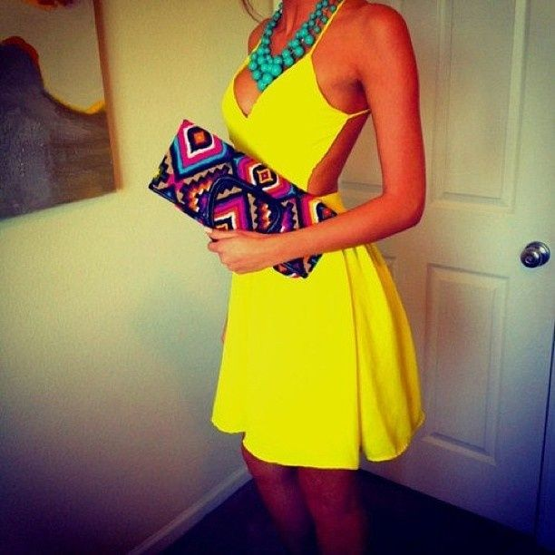 Choose yellow cutout fit and flare dress for a glam and trendy getup.   Shop this look on Lookastic: https://lookastic.com/women/looks/yellow-cutout-skater-dress-multi-colored-clutch-mint-necklace/11514   — Mint Necklace  — Yellow Cutout Skater Dress  — Multi colored Clutch