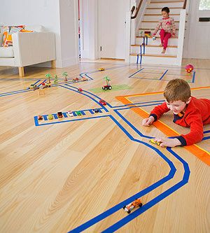 Fun! Car track made with painter's tape for easy removability. #DIY #toys #kids