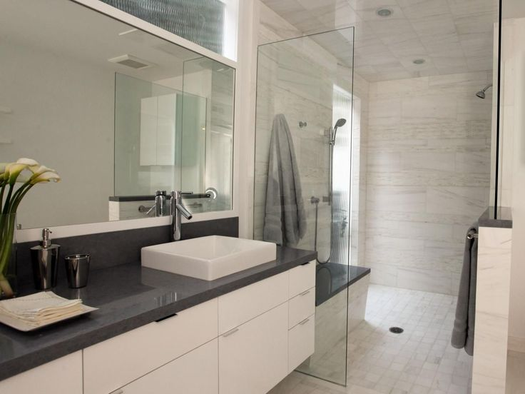 Best Photo Gallery Websites A fresh white motif flows throughout this chic modern bathroom space utilizing sleek lines of a cantilevered vanity minimalist cabinetry and open room