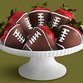 Football strawberries..would be fun for super bowl :)