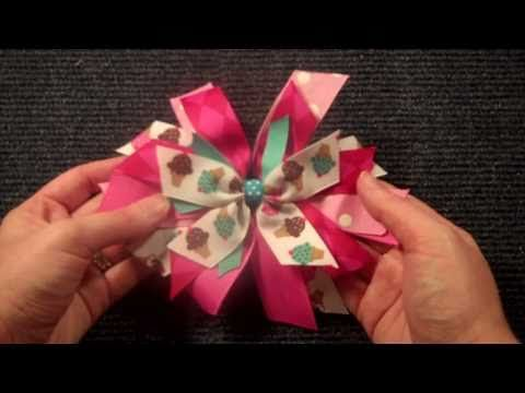 """How to make a basic """"Pinwheel"""" bow. These are cute just by themselves, or as part of the trendy """"Stacked"""" boutique hair bow. By the way, the woman who does these videos on YouTube is fantastic! Her instructions are very clear and easy to follow. I think she has like 81 videos available!"""