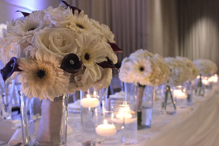 Use bouquets to decorate the head table