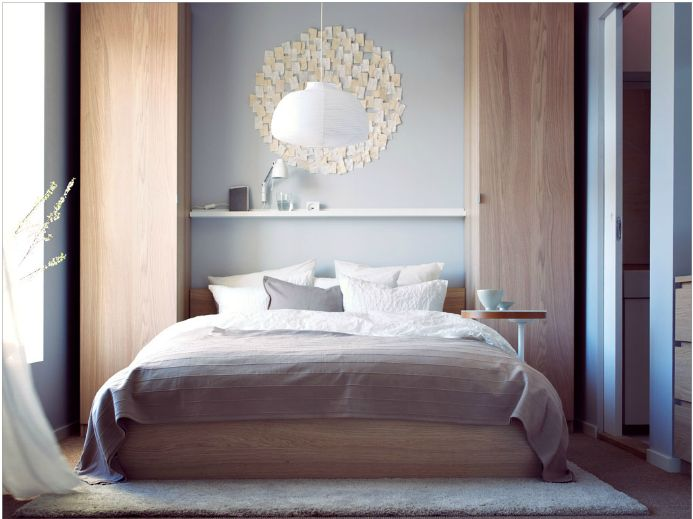 small bedroom inspiration from IKEA. the duel PAX wardrobes and shelf in between would suit perfectly in my bedroom (if only it was wide enough).