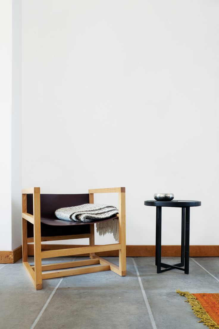 One Corner Holds A Chair And Table Designed By Verheyden.