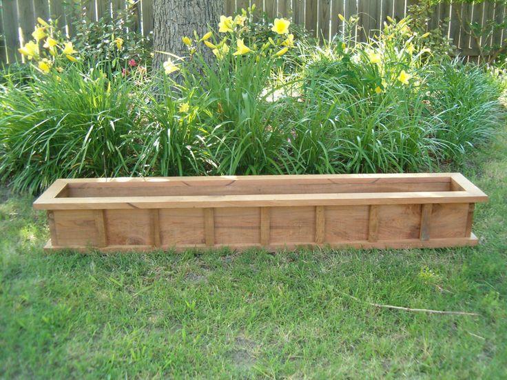 Exterior. Handmade Long Wooden Wheelbarrow Planter Box