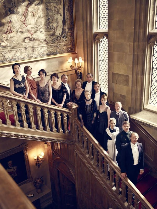 Downton Abbey Season 2 cast on the Great Oak Staircase in Highclere Castle, South East England, UK.