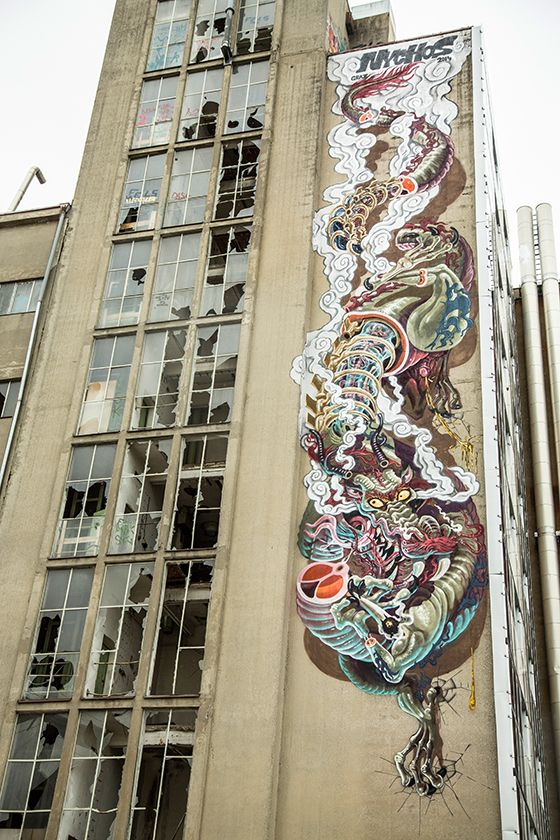 """Nychos: """"Puff the Magic Dragon"""" for Livin Streets Festival in Graz.  Painted down eight stories of abandoned fish food factory near the center of Graz, """"Puff the Magic Dragon"""" is a wicked, fuming Chinese dragon whose name may or may not have something to do with what's in the dragon's claw."""
