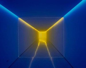James Turrell creates space by using light and color in this piece.  The addition of the yellow light, especially how part of it is dragged towards the viewer, creates a feeling that it is farther away than it may really be.  If it were kept just blue, there would be a lack of depth.