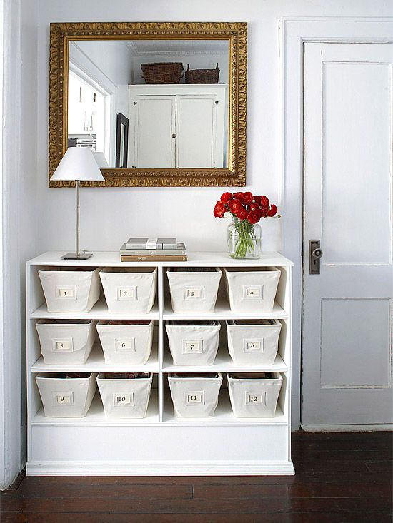 """Original Bookshelf Use Co-opt small spots of empty wall for attractive storage. -- Find (or build) a bookcase that fits the wall space. -- Fill with matching baskets or containers. We used canvas bins and dropped in numbered labels (a coordinating """"key"""" tucks into the first basket)."""