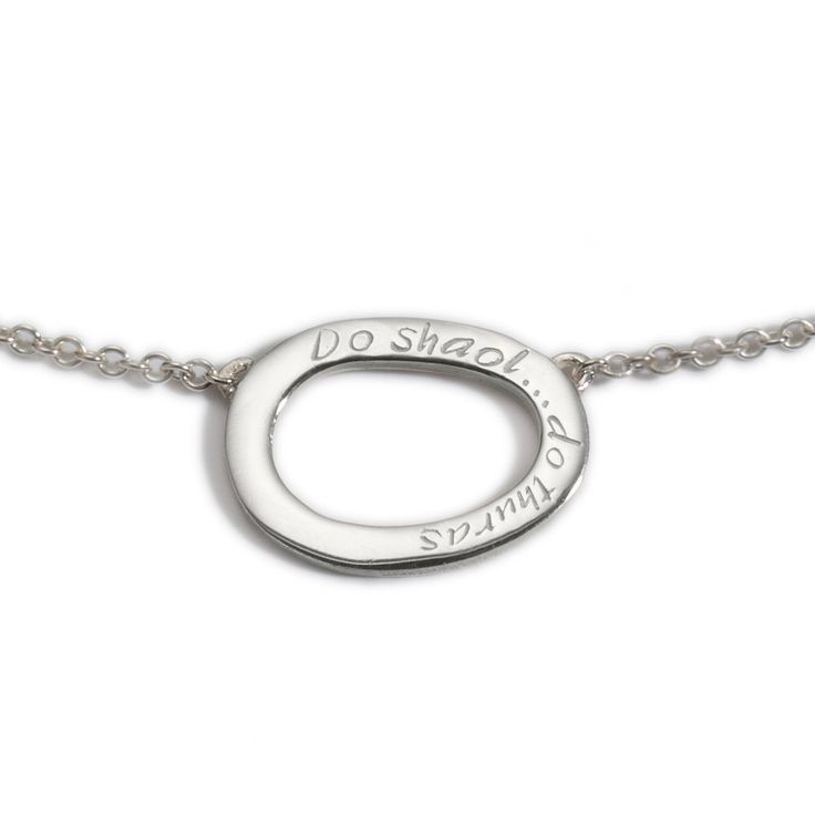 "A silver pendant inscribed with 'Do Shaol, Do Thuras' which translates from Irish as 'Your Life, Your Journey'. It's the slight irregularities that make it a beautiful piece. Sterling Silver Diameter: 22x17 mm 42-45cm/16""-18"" length (adjustable extension chain)   Available Here: http://www.standun.com/enibas-do-shaol-do-thuras-pendant.html"