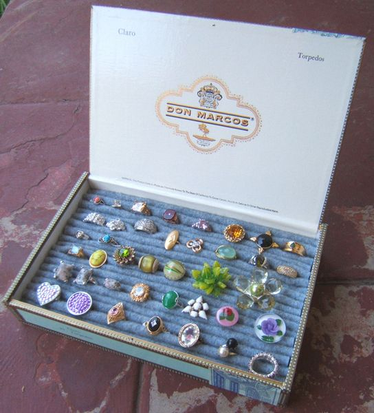 Cigar box + piece of an old sweater = neat storage for rings, earrings.