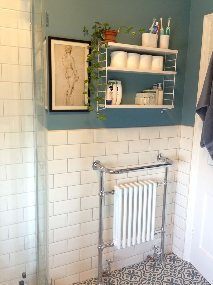 Radiator/Towel rail. Topps Tiles floor tiles. String Shelf. David print by Michelangelo from British Museum Shop. Stone Blue by Farrow & Ball