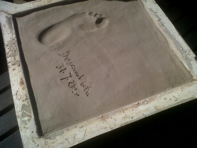 Archbishop Emeritus Desmond Tutu's footprint and signature added to the Footprints Project collection at Maropeng on July 31 2013.