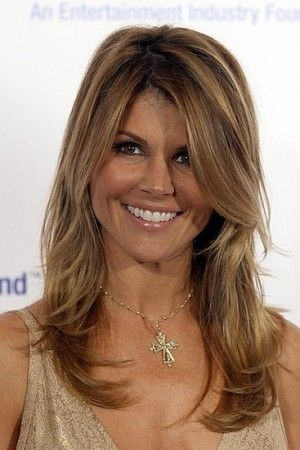 Lori Loughlin naturally wavy layered hair. This style is really good for casual summer days.