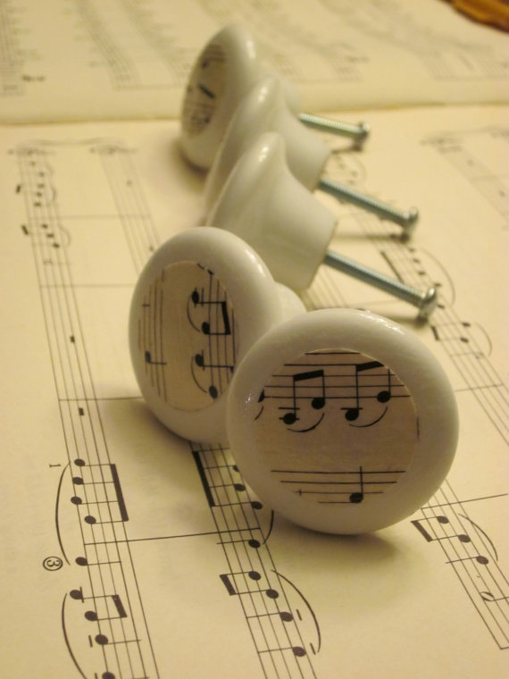 drawer pulls of vintage sheet music // get your Irish on these knobs ... I would use vintage 'coloured' postcard type pictures...