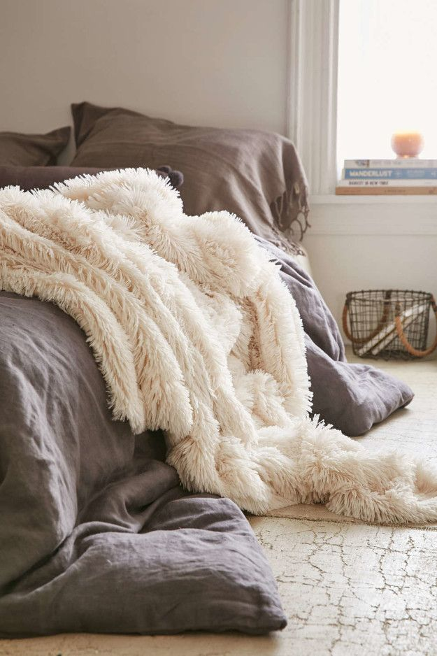 A faux lamb fur throw that'll make you feel like you live at Winterfell. | 21 Things That Will Make Your Bedroom Even Cozier