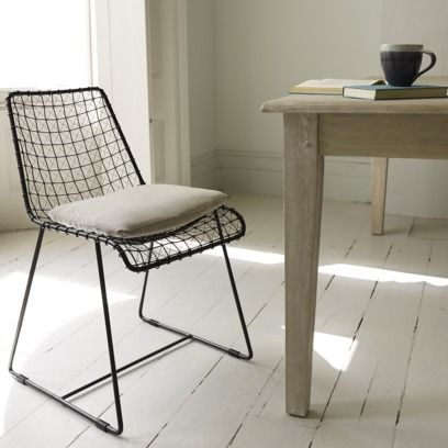GERONIMO GUNMETAL There aren't many chairs out there that look cool as well as original. But this creation, the work of very skilled metal workers, fits the bill nicely. A supremely comfy piece which works equally well with a modern or older-looking table. #kitchen