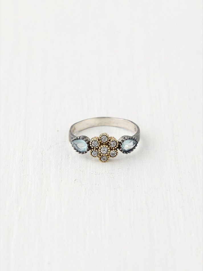 Bora 6 Petal Flower Ring at Free People Clothing Boutique