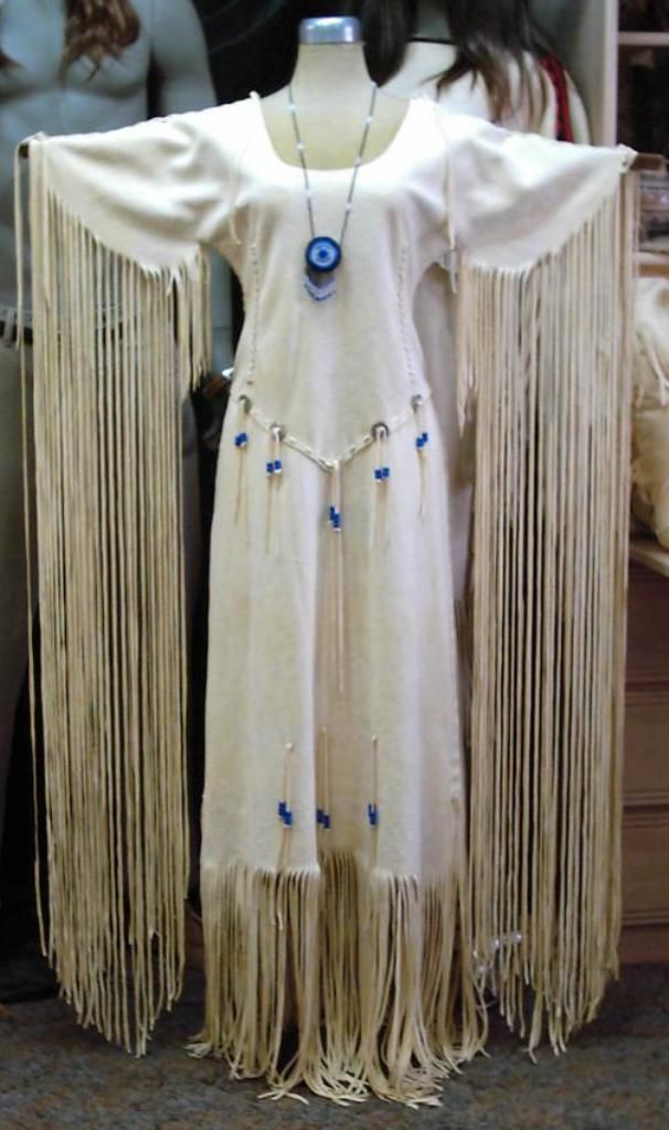 Light gold deer hide dress with lace up back. (necklace not included) http://nativeamericanstuff.net/Native%20American%20Style%20Crafted%20Clothing%20buckskins%20outfits%20moccasins%20and%20Handbags.htm
