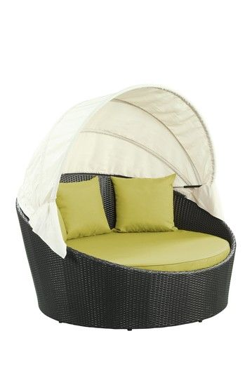 Siesta Outdoor Wicker Patio Canopy Bed - this would make my backyard hard to leave.