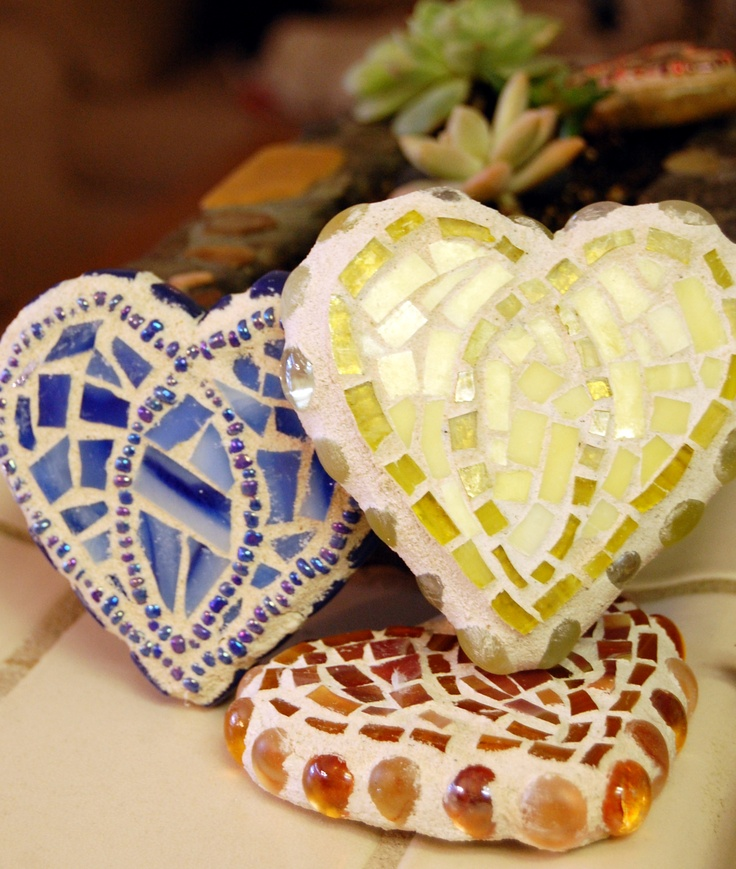 Make hearts from clay with cookie cutter then prosaic it with broken pottery