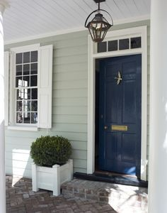 This color. Lacquered Life Church Street front door - Benjamin Moore Gentleman's Gray, with white shutters