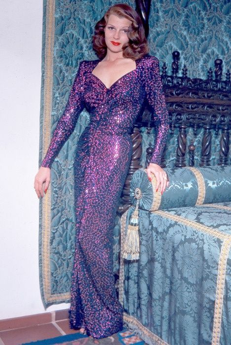 Rita Hayworth (1918-1987) was an American dancer and film actress who achieved fame during the 1940s as one of the era's top stars. | vintage 40s evening gown | 1940s purple dress