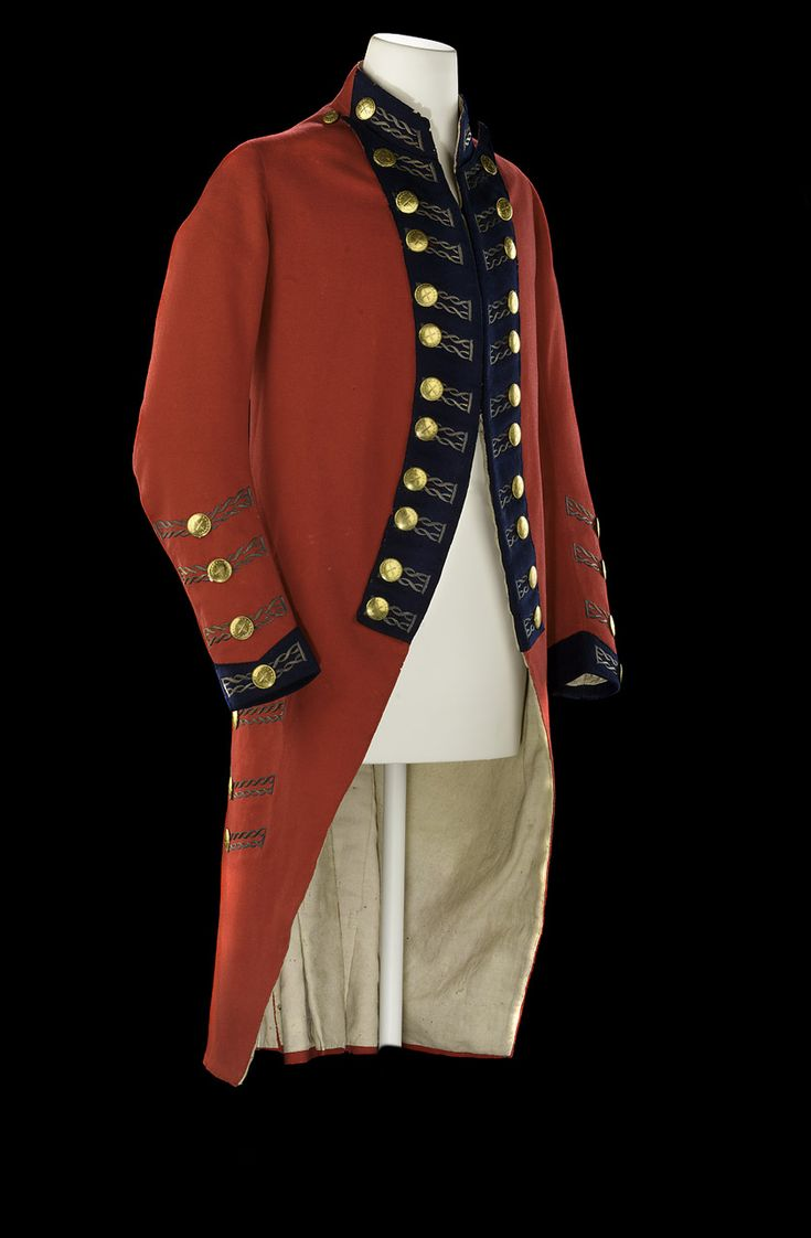 Royal Marines dress coat, England, 1782, brass, linen, metal thread, wool.  Worn by Major General Arthur Tooker Collins (1718-93). Constructed of red wool with cuffs & lapels faced with blue. The buttonholes are of embroidered metal thread & the cast brass buttons are stamped with a laurel wreath enclosing a crossed sword & baton. The skirts could be turned back, so the white lining of the coat created a contrast against the red wool of the skirts, and secured by means of hook and eye…